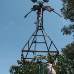 My daughter climbs up cyclecide's Axe Grinder