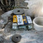 As the green sand mixture is done by weight, the bathroom scale helps out, covered with a high tech scratchproof cover